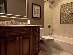 Small Bathroom With Decorative Tile - Tile Floor