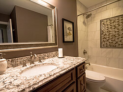 Small Bathroom With Decorative Tile - Countertop