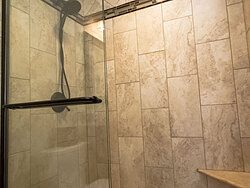 Small Bathroom With Decorative Tile - Shower Detail
