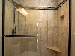 Small Bathroom With Decorative Tile - Glass Shower