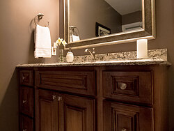 Small Bathroom With Decorative Tile - Bathroom Cabinets