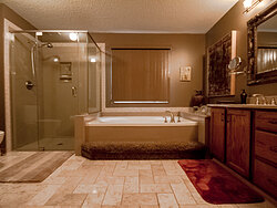 Warm Bathroom With Glass Shower - Remodeling