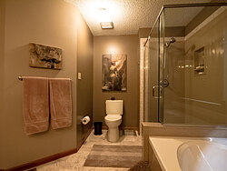 Warm Bathroom With Glass Shower - Toilet