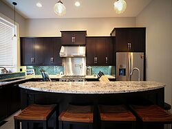 Contemporary Kitchen With Accent Wall - Island Countertop
