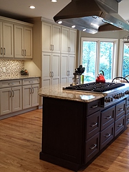 Transitional Kitchen With Island Cooktop - Wood Floor