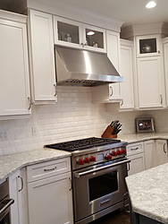 White Kitchen With Granite Countertops - Oven and Hood