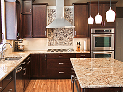 Warm Kitchen With Backsplash Details - Shaker Cabinets