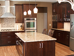 Warm Kitchen With Backsplash Details - Center Island