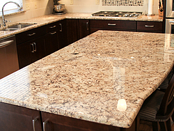 Warm Kitchen With Backsplash Details - Island Countertop