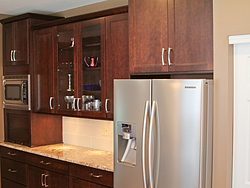 Warm Kitchen With Backsplash Details - Refrigerator