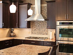 Warm Kitchen With Backsplash Details - Stovetop