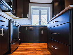Contemporary Kitchen With Shaker Cabinets - Wood Floors