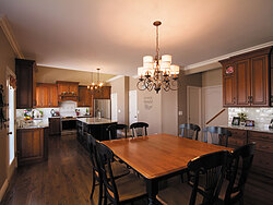 Traditional Kitchen With Center Island - Wood Floors