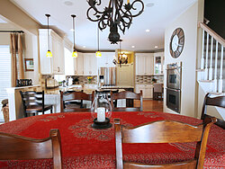 Transitional Kitchen With Accent Island - Kitchen Table