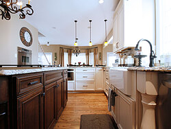 Transitional Kitchen With Accent Island - Wood Floor
