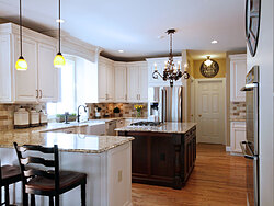 Transitional Kitchen With Accent Island - Peninsula Seating