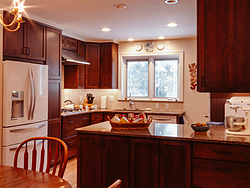 Contemporary Cherry Kitchen - Dining View