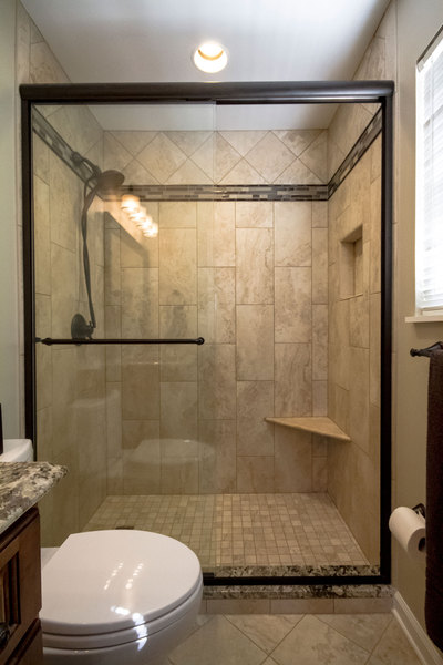 Small Bathroom With Decorative Tile   Glass Shower Door